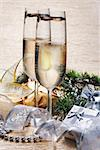Two champagne glasses with presents and decorative ribbon