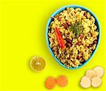 Spicy south indian breakfast called chitranna or poha with its ingredients - lemon, ginger and fresh turmeric. Stock Photo - Royalty-Free, Artist: smarnad                       , Code: 400-06078372