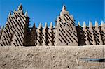 The Great Mosque of Djenn is the largest mud brick or adobe building in the world and is considered to be the greatest achievement of the Sudano-Sahelian architectural style. Stock Photo - Royalty-Free, Artist: michelealfieri                , Code: 400-06079841