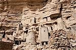 The principal Dogon area is bisected by the Bandiagara Escarpment.  The Dogon are best known for their mythology, their mask dances, wooden sculpture and their architecture.