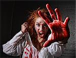 Woman in Horror Situation With Bloody Face Stock Photo - Royalty-Free, Artist: tobkatina                     , Code: 400-06082834