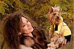 woman with curls and a little dog in nature, fall Stock Photo - Royalty-Free, Artist: artfotoss                     , Code: 400-06084012