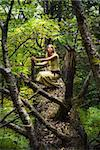 Blond girl dressed in dress walk in a magic forest Stock Photo - Royalty-Free, Artist: Fotolit                       , Code: 400-06084205