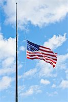 flag at half mast - American flag on a blue sky during a windy day Stock Photo - Royalty-Freenull, Code: 400-06086537