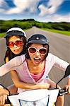 two girls riding scooter on the road Stock Photo - Royalty-Free, Artist: tomwang                       , Code: 400-06088320