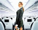 beautiful flight attendant on board of big plane Stock Photo - Royalty-Free, Artist: ssuaphoto                     , Code: 400-06088383