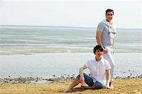 Gay guys being by water at low tide Stock Photo - Royalty-Freenull, Code: 400-06091653