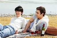 Homosexual couple enjoying themselves having a picnic at seaside Stock Photo - Royalty-Freenull, Code: 400-06091660