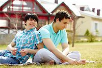 Young gays sitting together on the lawn enjoying warm weather Stock Photo - Royalty-Freenull, Code: 400-06091668