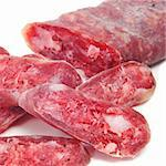 some fuet, spanish salami, on a white background Stock Photo - Royalty-Free, Artist: nito                          , Code: 400-06092455