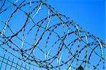 barbed wire against blue sky as war background Stock Photo - Royalty-Free, Artist: jonnysek                      , Code: 400-06093673