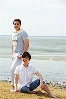 Young gay couple spending a sunny day at waterside Stock Photo - Royalty-Freenull, Code: 400-06096493
