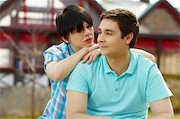Young homosexuals enjoying each other?s company in townhouse area Stock Photo - Royalty-Freenull, Code: 400-06096503