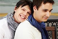 Portrait of smiling homosexual lovers dressed in elegant casual spending time outdoors Stock Photo - Royalty-Freenull, Code: 400-06096505