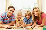 Family Playing Board Game At Home Stock Photo - Royalty-Free, Artist: MonkeyBusinessImages          , Code: 400-06098361