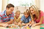 Family Playing Board Game At Home Stock Photo - Royalty-Free, Artist: MonkeyBusinessImages          , Code: 400-06098362