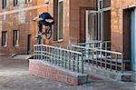 Biker doing high rail hop trick on bmx, back view