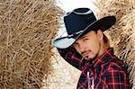 Cowboy in the Hay Stock Photo - Royalty-Free, Artist: megdypro4im                   , Code: 400-06102011