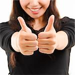 Young Asian female giving thumbs up sign isolated on white background Stock Photo - Royalty-Free, Artist: szefei                        , Code: 400-06103393