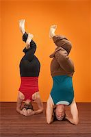 feet gymnast - Two fit women in upside down position with interweaved legs Stock Photo - Royalty-Freenull, Code: 400-06104091