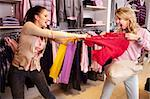 Image of two greedy girls fighting for red tanktop in department store Stock Photo - Royalty-Free, Artist: pressmaster                   , Code: 400-06104204