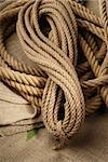 Naturel ropes twisted on a brown cloth Stock Photo - Royalty-Free, Artist: gorgev                        , Code: 400-06106316