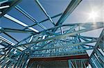 New residential construction home metal framing against a blue sky Stock Photo - Royalty-Free, Artist: LevKr                         , Code: 400-06106424