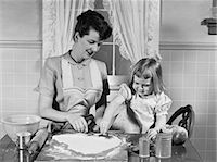 1950s MOTHER & DAUGHTER BAKING TOGETHER IN KITCHEN CUTTING DOUGH WITH COOKIE CUTTERS Stock Photo - Premium Rights-Managednull, Code: 846-06111873