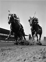 equestrian - 1960s WORM'S-EYE VIEW OF HORSE RACE WITH 2 LEADERS GALLOPING TOWARD CAMERA Stock Photo - Premium Rights-Managednull, Code: 846-06111881