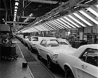 1960s INTERIOR OF FORD MUSTANG PLANT WITH NEARLY FINISHED CARS ON ASSEMBLY LINE Stock Photo - Premium Rights-Managednull, Code: 846-06111909
