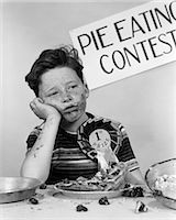 1950s BOY WINS 1ST PRIZE AT PIE-EATING CONTEST AND LOOKS SICK Stock Photo - Premium Rights-Managednull, Code: 846-06111964