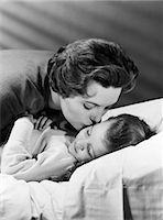 1950s MOTHER GIVING DAUGHTER A GOODNIGHT KISS Stock Photo - Premium Rights-Managednull, Code: 846-06111999