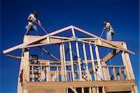 1980s BUILDING A NEW HOUSE WITH LUMBER RAISING THE  A-FRAME FOR THE ROOF LINE Stock Photo - Premium Rights-Managednull, Code: 846-06112019