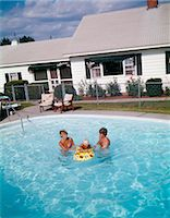 1980 1980s RETRO FAMILY MOM DAD BABY BACKYARD SWIMMING Stock Photo - Premium Rights-Managednull, Code: 846-06112104
