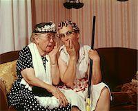 1960s TWO SENIOR OLDER WOMEN SITTING ON SOFA GOSSIPING Stock Photo - Premium Rights-Managednull, Code: 846-06112110