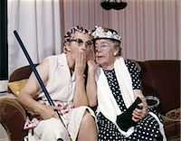 1960s TWO SENIOR OLDER WOMEN SITTING ON SOFA GOSSIPING Stock Photo - Premium Rights-Managednull, Code: 846-06112111