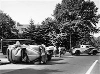 1940s CONVERTIBLE TOWED AWAY BY TOW TRUCK AFTER TRAFFIC ACCIDENT WITH SEDAN OUTDOOR Stock Photo - Premium Rights-Managednull, Code: 846-06112163