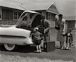 1950s FAMILY PACKING TRUNK OF 1953 CHEVROLET WITH SUITCASES