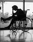 1950s 1960s SILHOUETTE OF WOMAN IN WHEELCHAIR WITH LEG PROPPED UP IN CAST & HOLDING HAND ON FOREHEAD