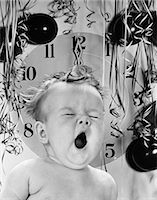 1940s 1950s BABY YAWNING WITH BALLOONS STREAMERS & CLOCK STRIKING MIDNIGHT IN BACKGROUND Stock Photo - Premium Rights-Managednull, Code: 846-06112214