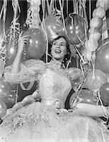 streamer - 1950s WOMAN IN PARTY DRESS SURROUNDED BY STREAMERS & BALLOONS Stock Photo - Premium Rights-Managednull, Code: 846-06112218