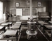 1900s OLD TIME  PIONEER CLASSROOM WITH PIANO & WOOD-BURNING STOVE Stock Photo - Premium Rights-Managednull, Code: 846-06112256