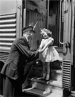 1950s CONDUCTOR GREETING LITTLE GIRL ON TRAIN STEPS Stock Photo - Premium Rights-Managednull, Code: 846-06112359