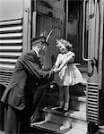 1950s CONDUCTOR GREETING LITTLE GIRL ON TRAIN STEPS