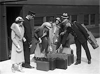 platform - 1920s 1930s TRAVELERS ON TRAIN PLATFORM IDENTIFYING LUGGAGE FOR PORTER Stock Photo - Premium Rights-Managednull, Code: 846-06112367