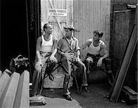 1930s 1940s THREE WORKMEN SITTING UNDER NO SMOKING SIGN SMOKING CIGARETTE AND PIPE JOB SAFETY Stock Photo - Premium Rights-Managednull, Code: 846-06112394