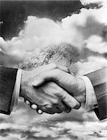 1940s BUSINESSMEN'S HANDS IN HANDSHAKE SUPERIMPOSED ON BACKGROUND OF GLOBE BURIED AMONG CLOUDS Stock Photo - Premium Rights-Managednull, Code: 846-06112411