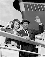 1960s COUPLE HUSBAND AND WIFE SMILING WAVING FROM CRUISE SHIP OUTDOOR Stock Photo - Premium Rights-Managednull, Code: 846-06112429