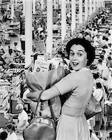 1960s HOUSEWIFE LOOKING AT CAMERA HOLDING GROCERY BAG SUPERIMPOSED OVER GROCERY STORE CHECK-OUT LINES Stock Photo - Premium Rights-Managednull, Code: 846-06112437