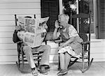 1970s ELDERLY COUPLE IN ROCKING CHAIRS ON PORCH MAN READING NEWSPAPER WHILE WIFE HOLLERS AT HIM Stock Photo - Premium Rights-Managed, Artist: ClassicStock, Code: 846-06112466